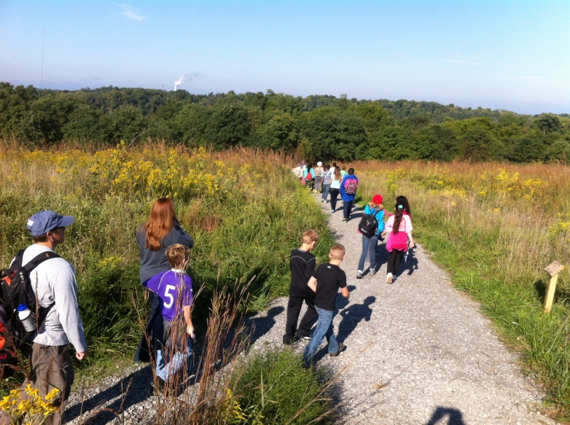 Fourth-grade students from Garrard and Jessamine counties hike in The Nature Conservancy's Dupree Nature Preserve.