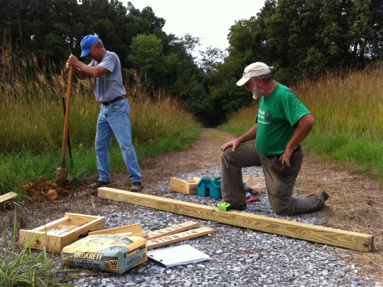 The Conservancy's Kentucky nature preserve stewards, Lynn Schwantes and Ken Brooks, build a new sign-in station at the Mantle Rock Nature Preserve.